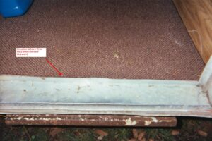 Photo of trim and location where it had been previously dented.