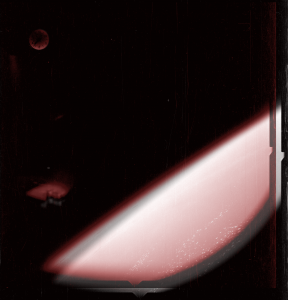 This is an overlay of both photographs (skipping the other photos taken sequentially, where the object did not exist thus possibly ruling out a reflection) and showing the object may be in different positions. This may prove the object may not be a reflection of something inside the craft, as proposed by some skeptical of these photos.