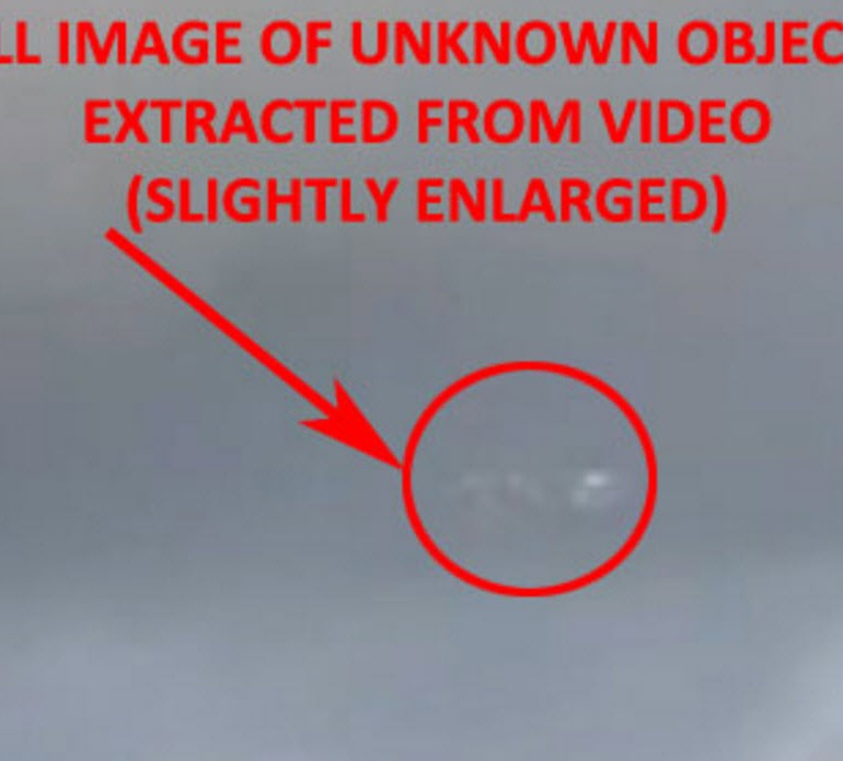 Video Taken of Unknown Object(s) Near Clouds