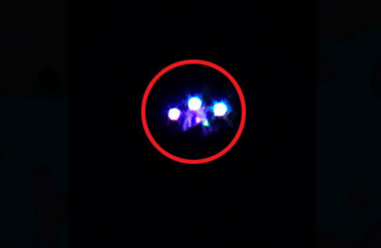 Viewers spooked by bizarre footage of giant purple UFO floating in night sky