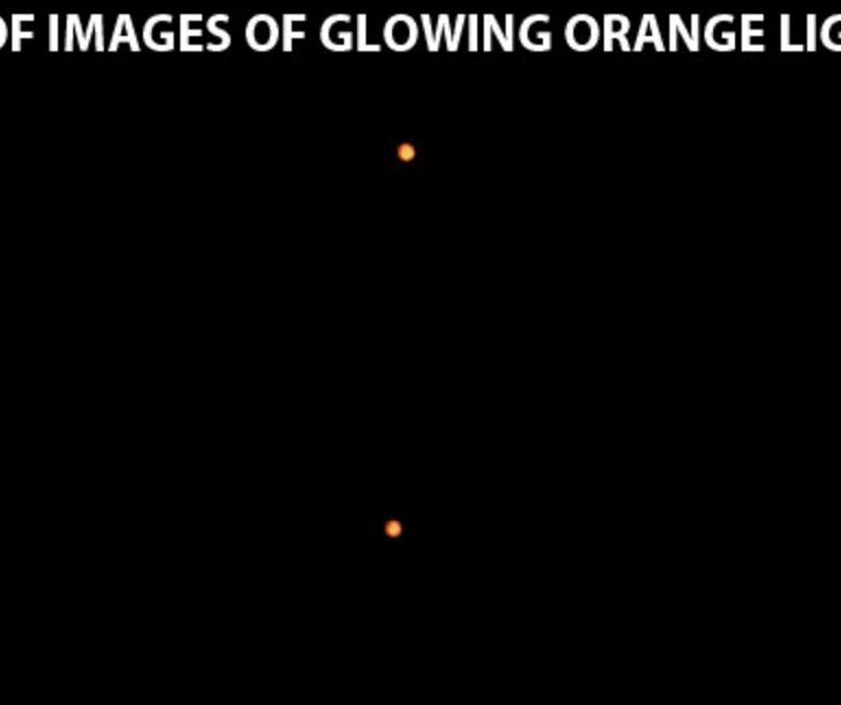 2 Orange Glowing Lights Move Around Each Other, Long Island, New York