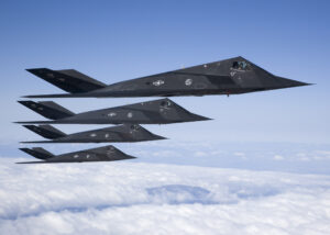 Four F-117 Nighthawks fly in formation during a sortie over the Antelope Valley recently. After 25 years of history, the aircraft is set to retire soon. As the Air Force's first stealth fighter, the F-117 is capable of performing reconnaissance missions and bombing critical targets, all without the enemy's knowledge. (Photo by Bobbi Zapka)