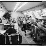 Photographic copy of photograph, 1973 (original photograph in 55th Wing Historian files, Offutt AFB, Bellevue, Nebraska). Interior view showing Major General Jerry Johnson and crew at work in battle staff compartment. - Offutt Air Force Base, Looking Glass Airborne Command Post, Looking Glass Aircraft, On Operational Apron covering northeast half of Project Looking Glass Historic District, Bellevue, Sarpy County, NE Photos from Survey HAER NE-9-B