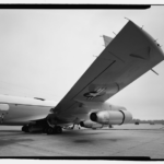 View showing underside of wing, looking glass aircraft. View to north. - Offutt Air Force Base, Looking Glass Airborne Command Post, Looking Glass Aircraft, On Operational Apron covering northeast half of Project Looking Glass Historic District, Bellevue, Sarpy County, NE Photos from Survey HAER NE-9-B
