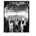 Interior of cockpit showing pilot and co-pilot seats with console and overhead instrument panels. View to northeast. - Offutt Air Force Base, Looking Glass Airborne Command Post, Looking Glass Aircraft, On Operational Apron covering northeast half of Project Looking Glass Historic District, Bellevue, Sarpy County, NE Photos from Survey HAER NE-9-B