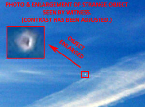 A Man Saw & Took Photo of White UFO Near Contrail