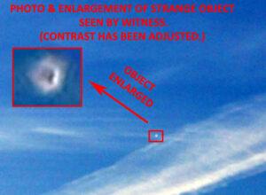 A Man Saw & Took Photo of White UFO Near Contrail
